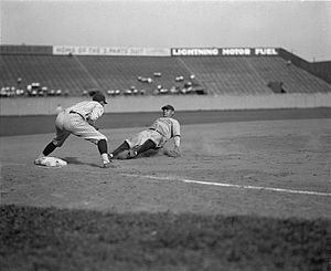 1925 New York Yankees season - Babe Ruth sliding into third base at Griffith Stadium in Washington, D.C., on June 23, 1925. Washington Senators third baseman Ossie Bluege looks on.