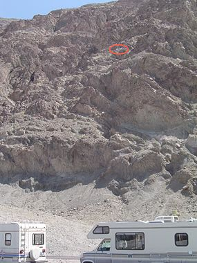 Sea level sign seen on cliff (circled in red) at Badwater Basin, Death Valley National Park BadwaterSL.JPG