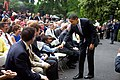 Barack Obama bumps fists with a child following the ceremony for the 2008 World Series Champion Philadelphia Phillies (P051509SA-0182 (3583566608)).jpg