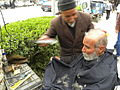 Barber on the sidewalk of a street in Nishapur 6.JPG