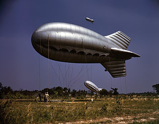 Barrage balloon large balloon tethered with metal cables