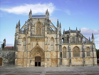 Portuguese Gothic architecture - Flamboyant Gothic in the Monastery of Batalha: church façade (left) and Founder's Chapel (right).