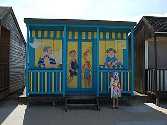 Mablethorpe - A child examines a decorated beach hut on Mablethorpe's seafront
