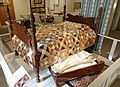 Bedstead, New England, 1820-1840, grain-painted wood, with quilt, Concord, 1847-1849, calico, cotton, and trundle bed, New England, 1820-1840, maple, pine - Concord Museum - Concord, MA - DSC05874.JPG