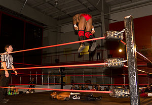 Sabian (wrestler) - BLK Jeez performing a diving splash.