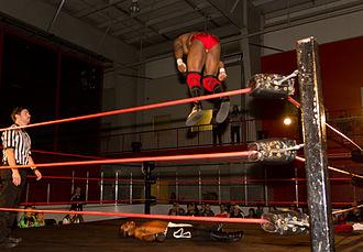 Sabian (wrestler) - BLK Jeez performing a diving splash.