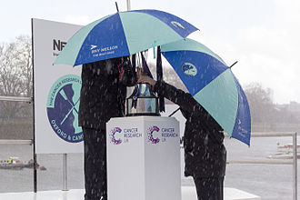 The Boat Races 2016 - Men's race winner's trophy under shelter during a brief hailstorm before the race coin toss