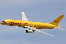Side view of yellow twin-engine jet inflight