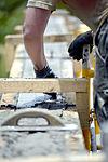 Bond beam work at Gabriela Mistral School construction site 150622-F-LP903-752.jpg