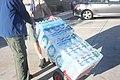 Boy Scouts Wheeling Donated Water Bottles.jpg