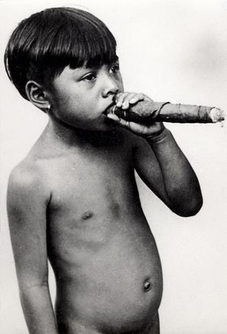 Cigar - Boy from the Philippines smoking a cigar, 1931
