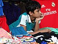 Boy in Clothing Stall - Sylhet - Bangladesh (12969324744).jpg