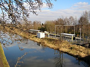 Timperley - The Bridgewater Canal with Timperley Metrolink station in the background