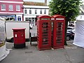 Bridport, postbox No. DT6 2000 and phones, West Street - geograph.org.uk - 1364362.jpg