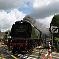 Brockenhurst - 34067 with a down train on the level crossing.jpg