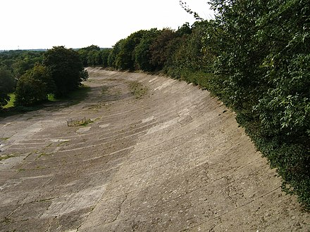 A remaining section of the Brooklands track in 2007 Brooklands Members' Banking from bridge.jpg