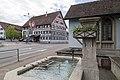 Brunnen bei der Kirche und Gasthaus Adler.jpg