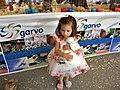 Bucharest, Romania. ROMEXPO. Exhibition of birds, 2018. A little girl loves a white han.jpg