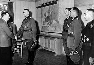 Knight's Cross of the Iron Cross - Adolf Hitler presenting Oak Leaves at a ceremony on 15 September 1943