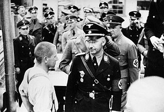 Dachau concentration camp - Heinrich Himmler (front right, beside prisoner) inspecting Dachau Concentration Camp on 8 May 1936.