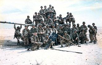 2nd Armored Division (United States) - Soldiers of 2nd Platoon, Company C, 1st Battalion, 41st Infantry Regiment, 2nd Armored Division (FWD) pose with a captured Iraqi tank during the 1st Gulf War, February 1991.