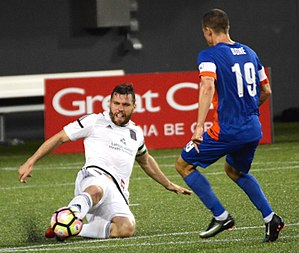 James Chambers (Irish footballer) - Chambers faces FC Cincinnati midfielder Corben Bone during a 2017 match