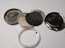 Inside pieces of a coin battery, refer to caption