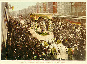 Mardi Gras in New Orleans - Rex in procession down Canal Street; postcard from around 1900