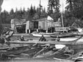 Canoes and a boathouse at Brockton Point 1897.jpg