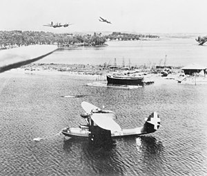CANT Z.501 - RAF Bristol Beaufighters sweep in at low level to attack the Italian seaplane base at Preveza, Greece. In the foreground is a CANT Z.501.