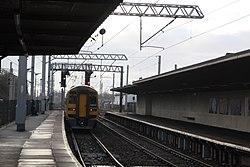 Carnforth - Arriva 158848 leaving for Preston.JPG