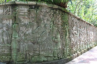 Kingdom of Singapura - Carved mural on a wall in Fort Canning Park depicting activities which may have occurred in 14th-15th century Singapore.
