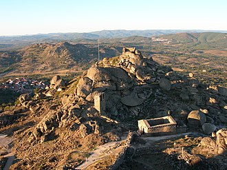 Castle of Monsanto - A view of the castle and walls draped over the hilltop of Monsanto (with the Chapel of Santa Maria do Castelo in the foreground)