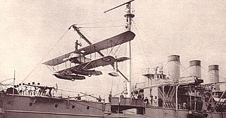 Caudron - A Caudron seaplane, being hoisted onboard La Foudre in April 1914