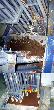 Fire-retardant, foamed plastic being used as a temporary dam for firestop mortar in a cable penetration in a pulp and paper mill on Vancouver Island, British Columbia, Canada.