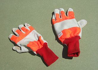 Chainsaw safety clothing - Chainsaw gloves. Note that only the back of the left hand glove contains chainsaw protective fabric, and so only that glove carries the chainsaw label.