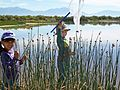 Children with Nets in Wetland (12660922985).jpg