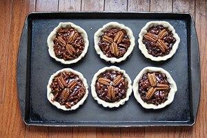 Pecan pie - Chocolate pecan tarts prior to baking