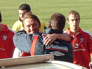 Viv Busby - Chris Brass hugs Busby after a game in 2004