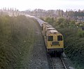 Class 20 Bo-Bo diesel locomotives nos. 20157 & 20170 with a train of granite chippings near Western Park, Leicester, Nigel Tout, 21.4.76.jpg