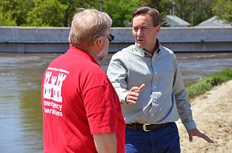 Rick Berg - Berg talking with U.S. Army Corps of Engineers official Roland Hamborg during the 2011 Souris River flood