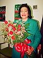Coretta with flowers.jpg