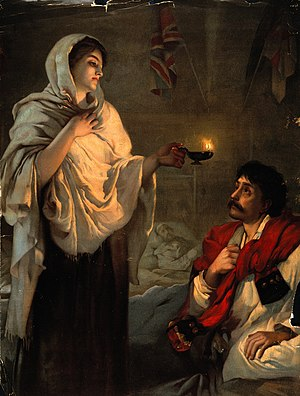 Crimean War; Florence Nightingale with her lamp at a patient Wellcome V0015794.jpg