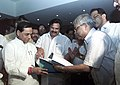 Dasari Narayan Rao witnessing the exchanging of signed documents of 5 year National Coal Wage Agreement-VII by the Joint Bipartite Committee for Coal Industry, a body of representatives of management of coal companies and workers.jpg