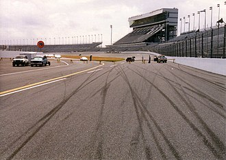 76 (gas station) - A 76 ball is visible (left) at Daytona International Speedway in the late 1990s.