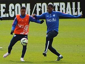 Georginio Wijnaldum - Wijnaldum (right) with Jonathan de Guzmán during international training in March 2015