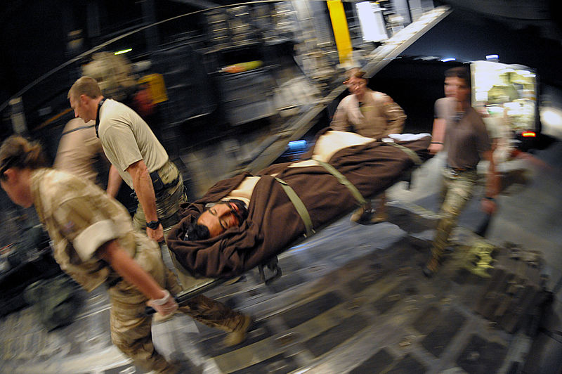 File:Defense.gov News Photo 100816-F-9631D-012 - Coalition forces carry an injured Afghan man onto a U.S. Air Force HC-130P N King aircraft in Helmand province Afghanistan on Aug. 16 2010. The.jpg