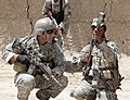 Defense.gov News Photo 110510-A-JQ157-005 - A U.S. Army soldier with Charlie Company 1st Squadron 38th Cavalry Regiment 525th Battlefield Surveillance Brigade and an Afghan counterpart.jpg