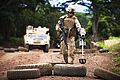 Defense.gov News Photo 110802-M-MM918-215 - U.S. Marine Corps Lance Cpl. David Engel an anti-tank missileman with Weapons Company 3rd Battalion 3rd Marine Regiment uses a mine detector to.jpg