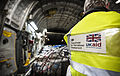 DfID worker checking supplies on a RAF C17 bound for the Philippines MOD 45156432.jpg